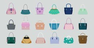 Handbag. Women  has a gray background Royalty Free Stock Image