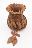 Handbag. Wool woven ladies brown handbagon white background Royalty Free Stock Images