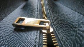 Handbag Zipper. Close-up of a leather briefcase zipper Stock Photo
