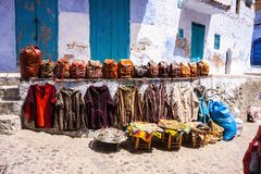 Handbags and clothing front of the shop, Chefchaouen, Morocco Royalty Free Stock Image