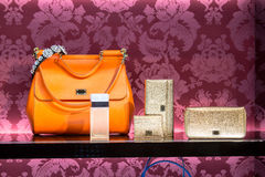 Handbags in a luxury fashion store. The showcase in a luxury fashion store with handbags royalty free stock photos