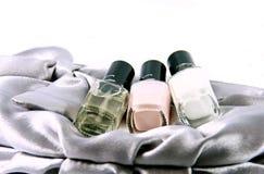 Handbags and nail polish Royalty Free Stock Photos