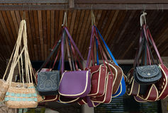 Handbags on open market display Stock Photo
