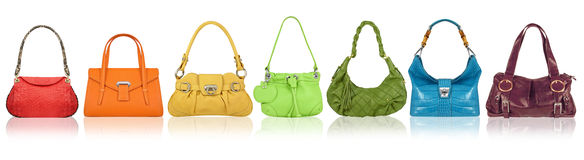 Handbags rainbow. A group of women multicolor handbags Stock Images