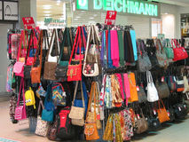 Handbags for sale in a shopping mall. stock photo