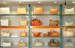 Handbags in the shop. Rows of handbags in the shop Stock Photos
