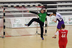 Handball action. Handball players Andrei Santeiu and Ionut Irimus, pictured in action during the game between Dinamo Bucharest and Politehnica Timisoara Stock Photos