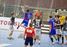 Handball game Motor vs Aalborg. KYIV, UKRAINE - OCTOBER 18, 2014: Sergiy Onufrienko of Motor (#33) attacks during European Handball Champions League game against stock image