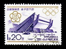 The handball gimnasium, Competitive facilities in the street Changchun, Pyongyang serie, circa 1987. MOSCOW, RUSSIA - NOVEMBER 24, 2017: A stamp printed in Stock Image