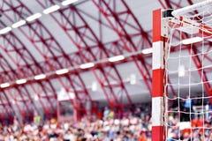 Handball goalpost with spectators in background Stock Images