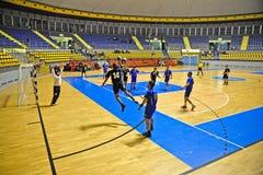 Handball match, player make a jump shot Royalty Free Stock Photo