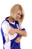 Handball player. Female handball player holding on arm, isolated in white Royalty Free Stock Photo
