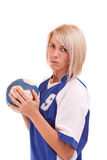 Handball player. Female handball player with a used ball, isolated in white Stock Photo