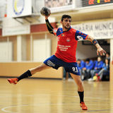 Handball player in action Stock Image