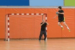 Handball player jumping with the ball. Trying to score a goal Royalty Free Stock Photos