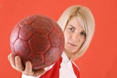 Handball player watching the ball Stock Images
