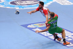Handball. Players, Ciprian Sandru from Dinamo Bucharest and Zeljko Musa from SC Magdeburg fighting for the ball during the Men's EHF Cup. The german team won Royalty Free Stock Photos
