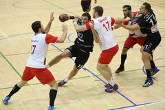 Handball. Players pictured in action during the game between Dinamo Bucharest and CS Minaur Baia Mare Stock Photos