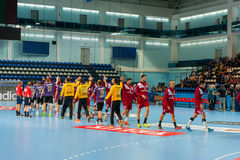 Handball teams greet each other Stock Photos