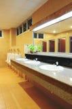 Handbasin and mirror in toilet Royalty Free Stock Photography