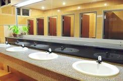 Handbasin and mirror in toilet Stock Image