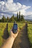 Handbediende GPS eenheid bij sleepvork Stock Afbeelding