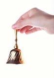 Handbell. Hand hold handbell isolated on white Royalty Free Stock Photos