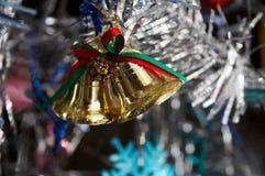 Handbells del oro Foto de archivo