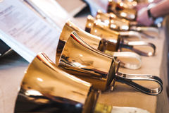 Handbells on table ready to perform Stock Photography