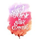 Handbeschriftung mit Text - glauben Sie einfach an Ihre Träume Stockbilder