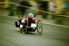 Handbike racer. Handbike race with panning effect royalty free stock images