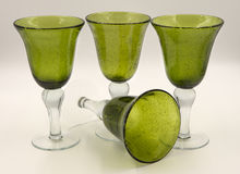 Handblown glass goblets for party. Handblown glass green goblet drinkware Stock Photos