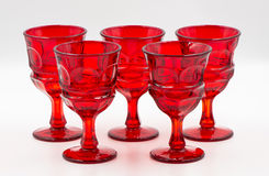Handblown glass goblets for party. Handblown glass red goblet stemware Royalty Free Stock Photos