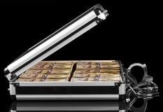Handbojor på fall med pengar Arkivfoton