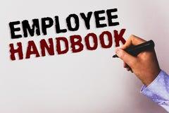 Handbok för anställd för ordhandstiltext Affärsidé för för reglementeregler för dokument manuell backg för vit för text för kod f Arkivfoto