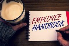 Handbok för anställd för ordhandstiltext Affärsidéen för för reglementeregler för dokument manuell kod för politik för resehandbo Arkivfoton
