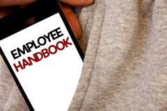Handbok för anställd för textteckenvisning Koden för politik för resehandboken för regler för reglemente för det begreppsmässiga  Arkivfoton