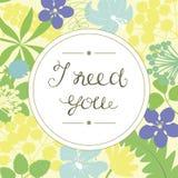 Handbokstäver behöver jag dig, utfört i rundan på en blom- bakgrund Royaltyfri Fotografi