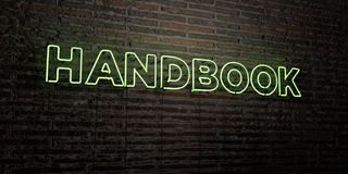 HANDBOOK -Realistic Neon Sign on Brick Wall background - 3D rendered royalty free stock image. Can be used for online banner ads and direct mailers Royalty Free Stock Image
