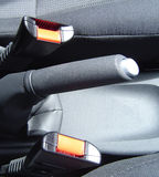 Handbrake and Seat belt fasteners Stock Photos