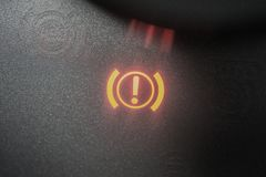 Handbrake warning light sign illuminated close up stock photo