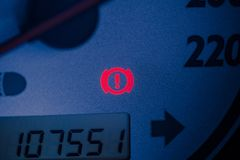 Handbrake warning light sign illuminated. Close up car dashboard royalty free stock image