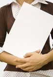 Handcard. Paper clean sheet in hands in the girl Royalty Free Stock Images