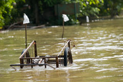 Handcart left at a flooded road Stock Photos