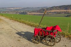 A handcart with a red blanket. stock images