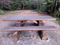 Handcarved picnic table. Beautifully handcarved picnic table in BC Canada Stock Photo