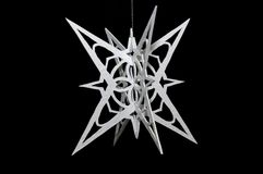 Handcarved snow flake. A handmade 3D snow flake cut out of formica Royalty Free Stock Photography