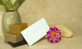 Handcarved soap. Handmade soap and handcarved flower soap and loofah sponge with blank card for text Stock Images