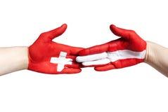 Handclap between switzerland and austria Stock Photo