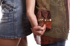 Handclasp. Of two girl friends on white background Royalty Free Stock Image